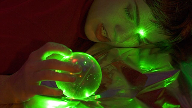 Catherine Elicson of Empath staring into laser globe