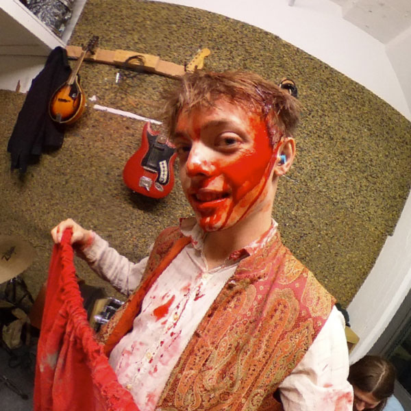 A bloodied up Carter McNeil takes a break on set of Ghost King's Buzzin